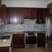 Tigris Garden kitchen with dark cabinets